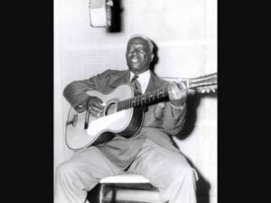Lead Belly playing guitar